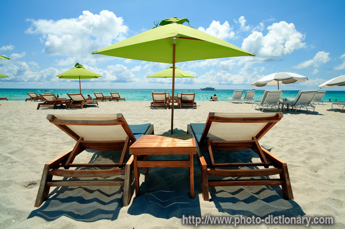 beach lounge chairs definition beach lounge chairs word and phrase image - Beach Lounge Chairs