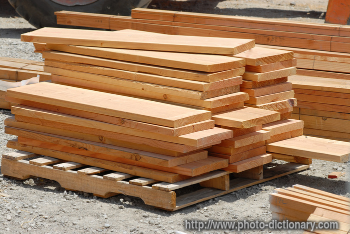 Stacks of lumber photo picture definition at photo Wood architecture definition