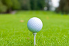 golf ball on tee - photo/picture definition - golf ball on tee word and phrase image