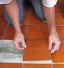 laying ceramic tile - photo/picture definition - laying ceramic tile word and phrase image