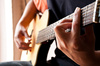 playing guitar - photo/picture definition - playing guitar word and phrase image