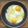 fried eggs - photo/picture definition - fried eggs word and phrase image