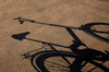 bicycle shadow - photo/picture definition - bicycle shadow word and phrase image