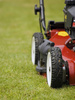 mowing grass - photo/picture definition - mowing grass word and phrase image