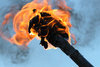 flaming torch - photo/picture definition - flaming torch word and phrase image