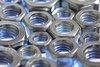metal nuts - photo/picture definition - metal nuts word and phrase image