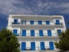 Greek apartment building - photo/picture definition - Greek apartment building word and phrase image