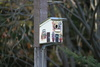bird house - photo/picture definition - bird house word and phrase image