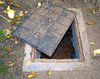 manhole cover - photo/picture definition - manhole cover word and phrase image