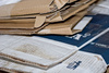 folded cardboard boxes - photo/picture definition - folded cardboard boxes word and phrase image