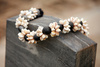 kukui nut shell lei - photo/picture definition - kukui nut shell lei word and phrase image