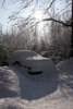 snow covered car - photo/picture definition - snow covered car word and phrase image